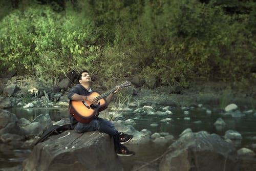 Free stock photo of boy, guitar, jungle