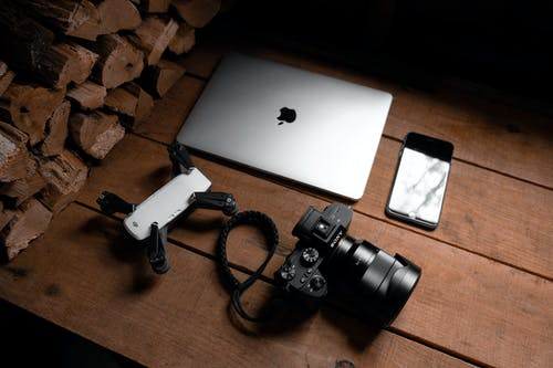 Photo Of Gadgets On Wooden Table