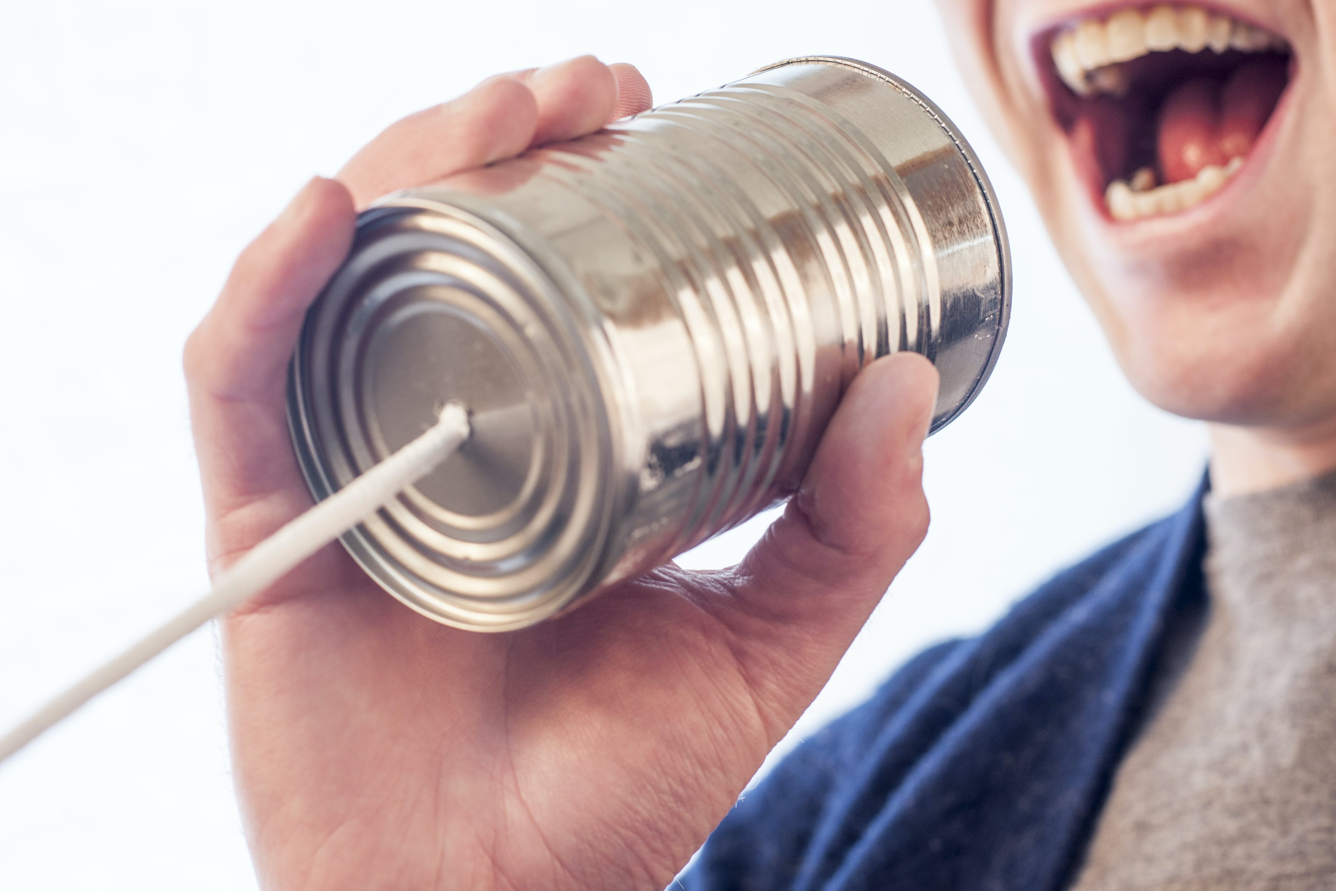 A tin can telephone - do not use it for communication during moving your office to Fort Lauderdale.
