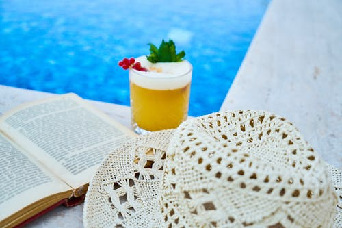 Clear Drinking Glass With Juice On A Poolside