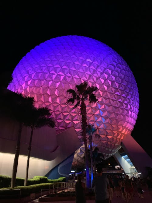 Purple and Pink  Lights On A Ball-Shaped Structure At Night Time