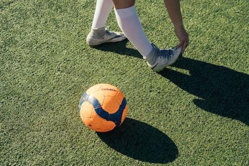 Photo Of Ball On Grass Field
