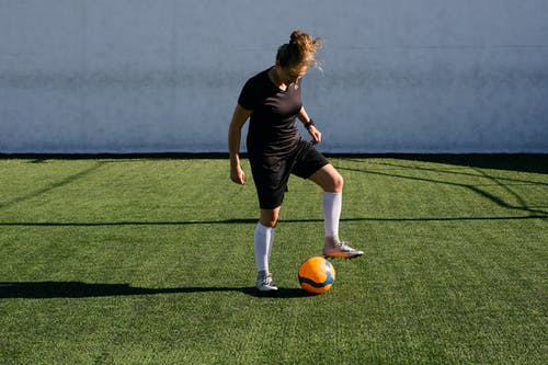 Woman Playing Soccer During Daylight