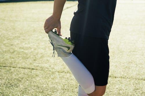 アクティビティ, アスリート, サッカー選手, ストレッチの無料の写真素材