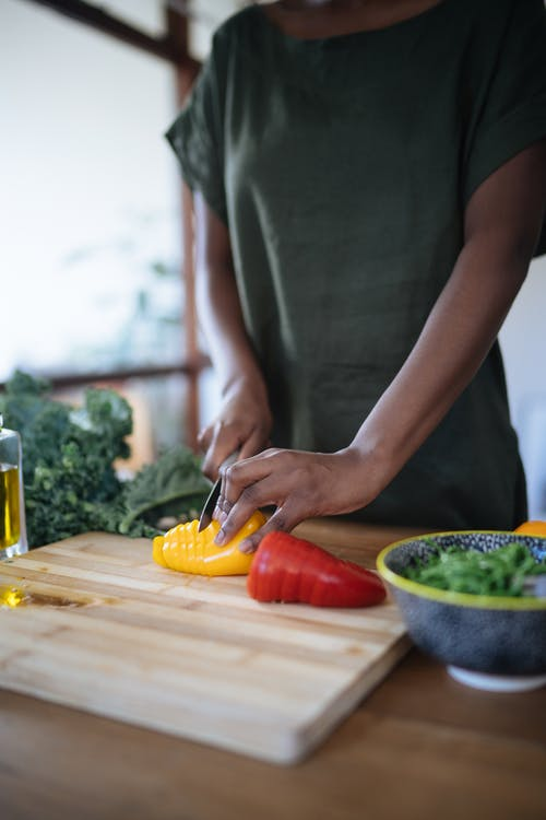 Photo Of Person Cutting Bell Peppers