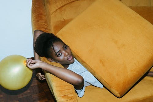 Photo Of Woman Laying On Couch
