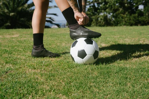 Person's Foot On A Soccer Ball