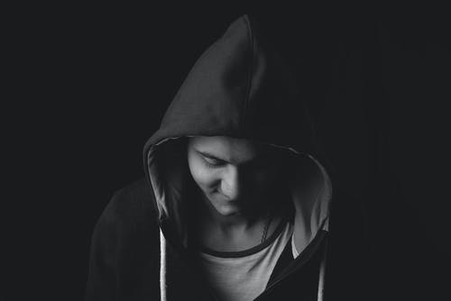 Grayscale Photo of Person in Hoodie