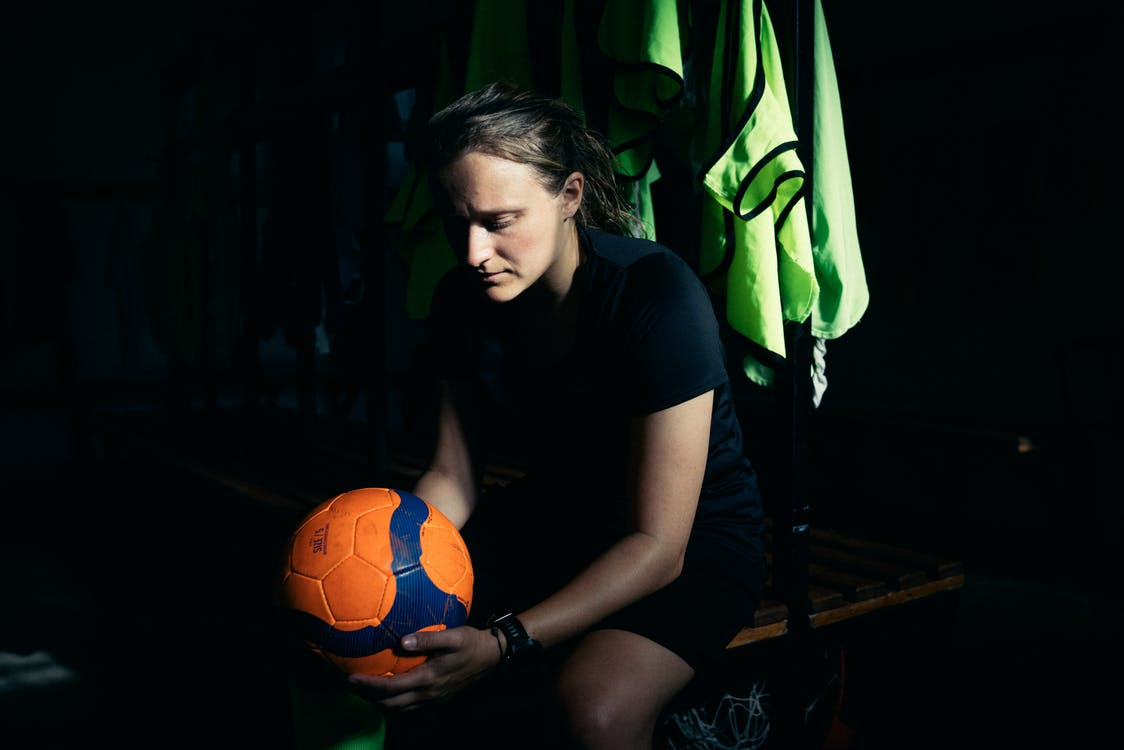 Person in Black Crew Neck T-shirt Holding Soccer Ball