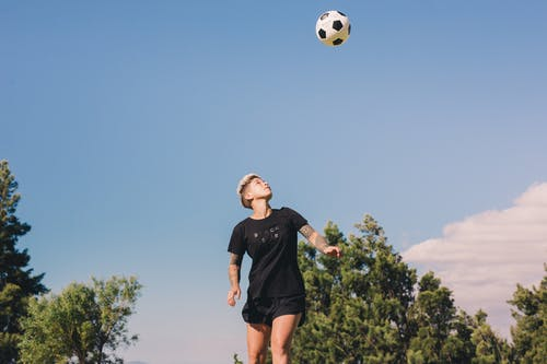 Photo of Person Playing With Soccer Ball