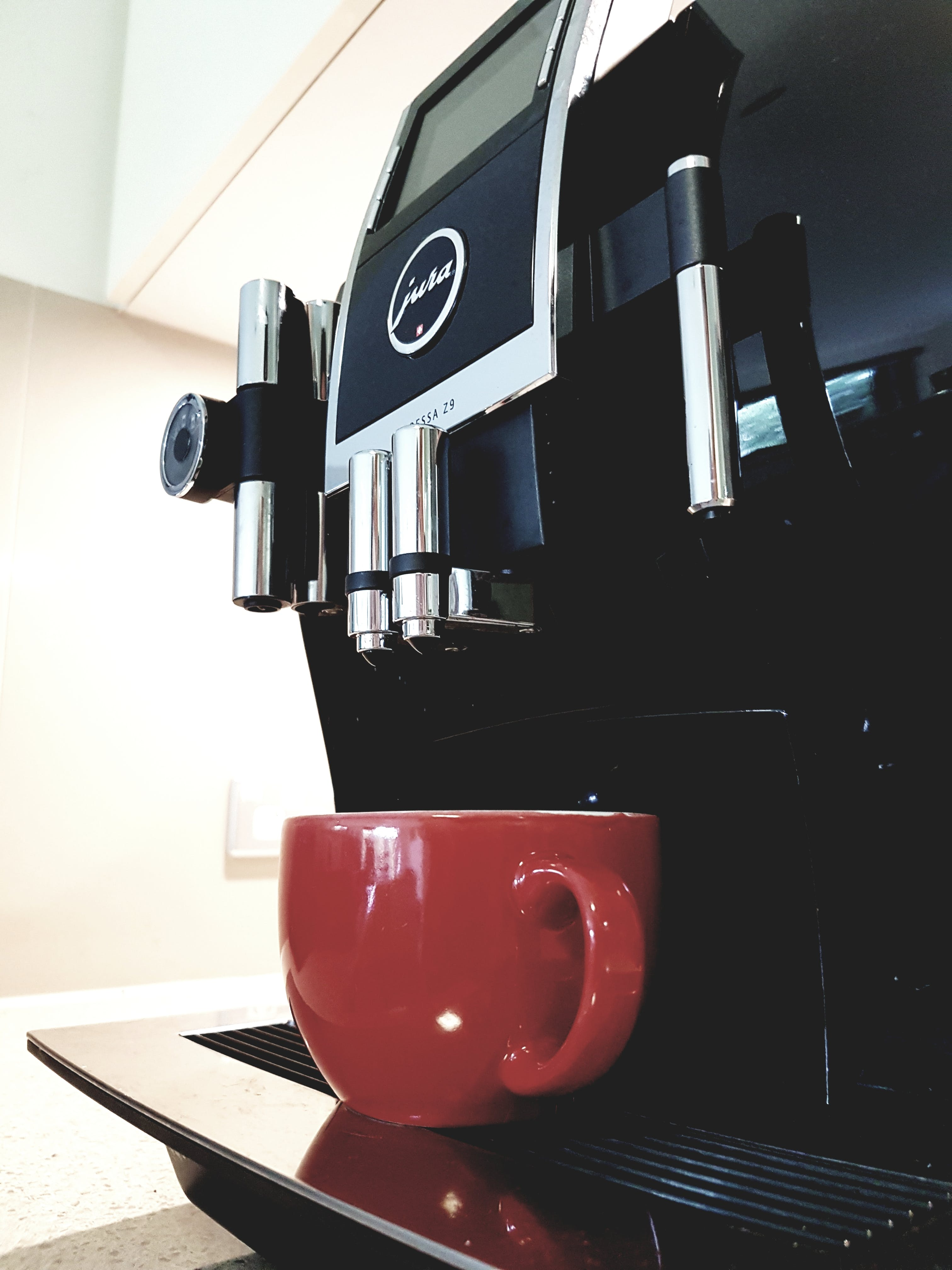 Black Coffeemaker With Red Ceramic Teacup