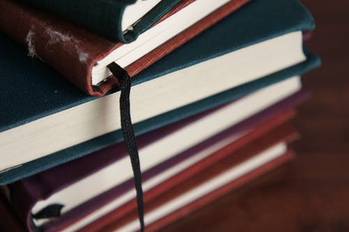 Close-up Photography of  books on Wooden Table