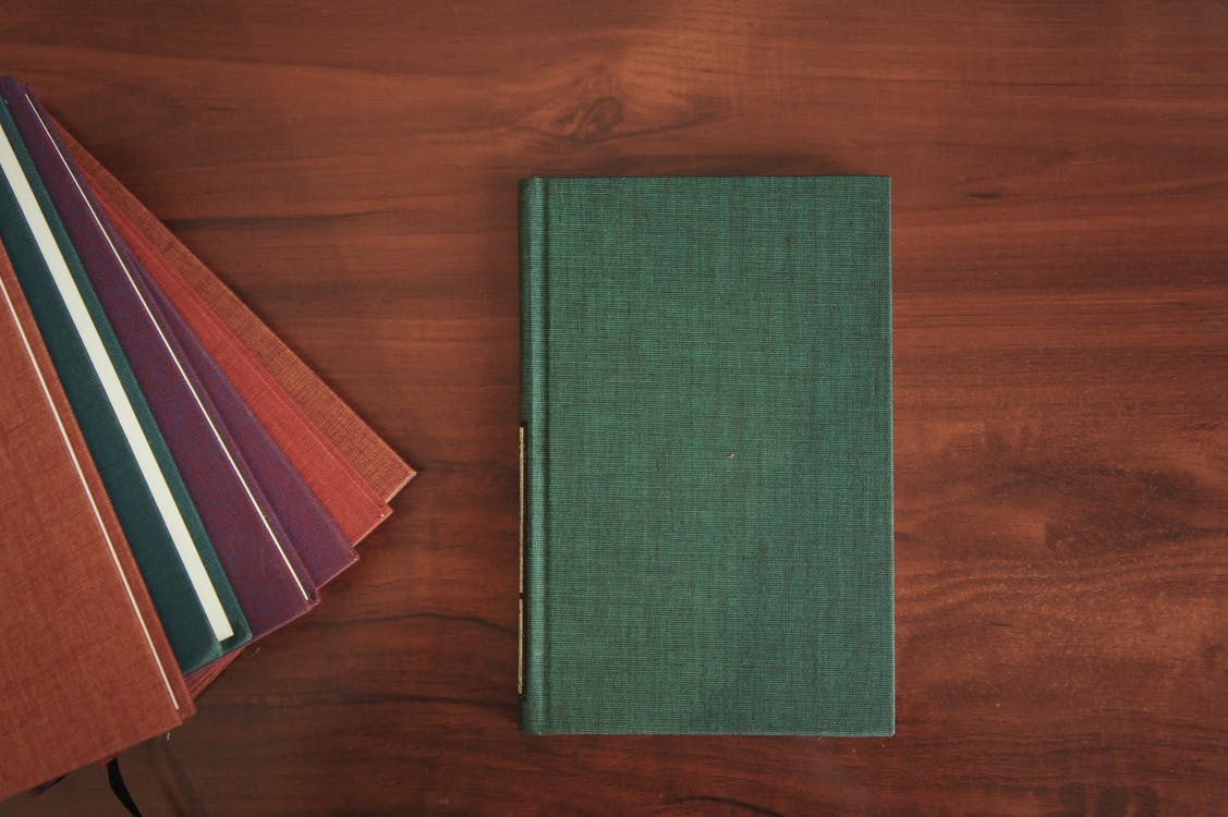 Books on Wooden Surface