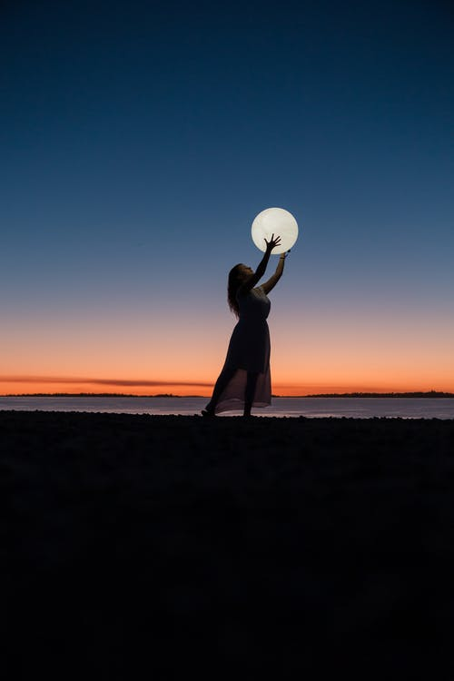Woman Holding a Moon