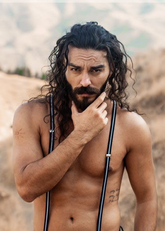 Topless Man With Black Hair and Suspenders