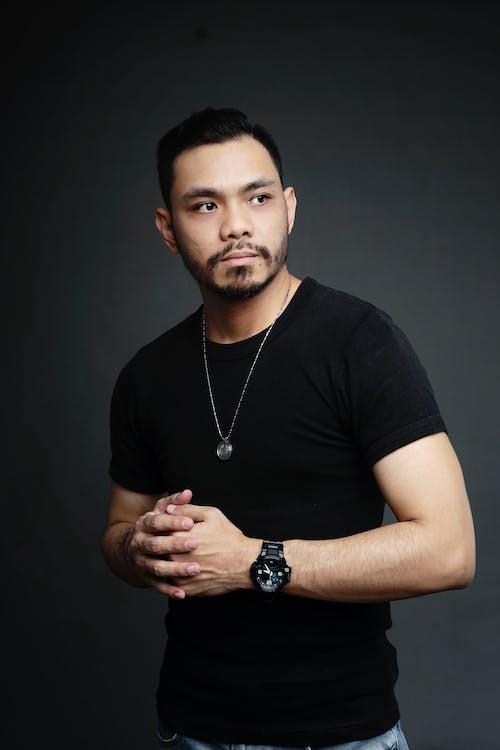 Photo of Man Standing While Wearing Black Shirt