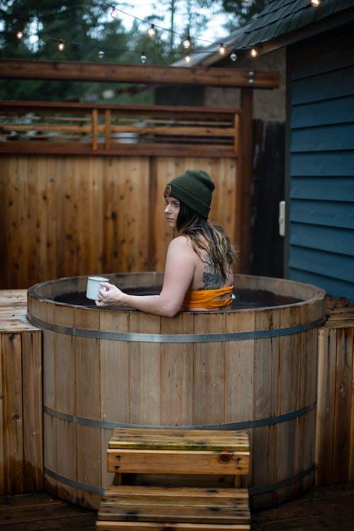 Woman Inside A Wooden Barrel Of Water