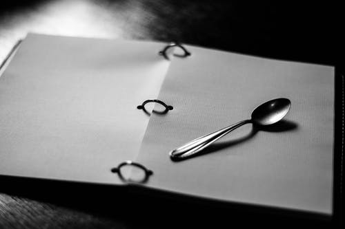 Silver Spoon on White Paper
