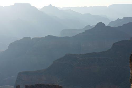 büyük Kanyon, gündoğumu, güneş gözlüğü içeren Ücretsiz stok fotoğraf