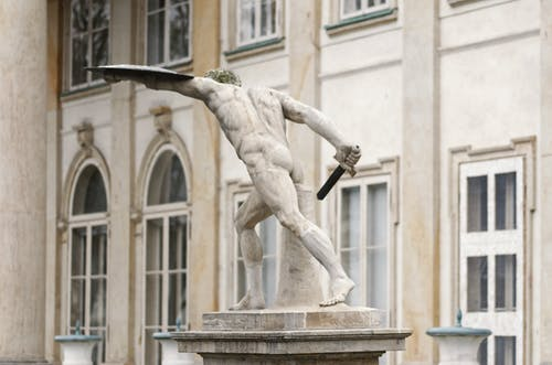 Statue Of A Man Holding a Sword