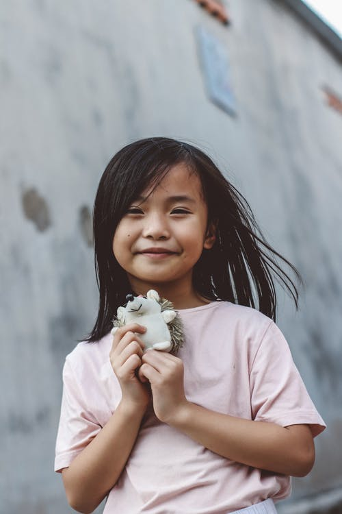 Little Girl Holding Her Stuffed Toy