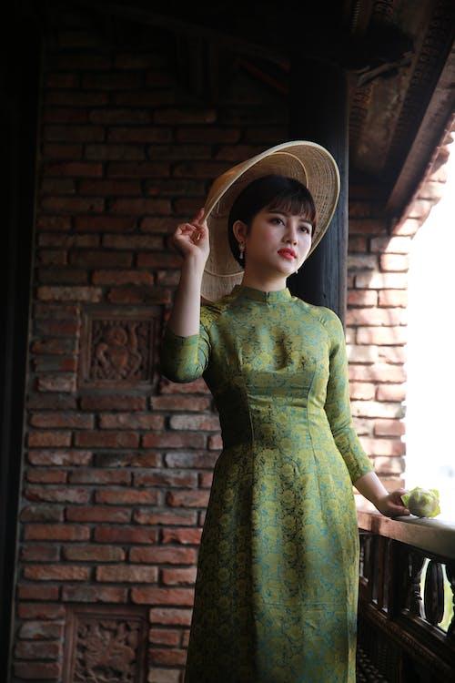 Woman in Green Long Sleeve Dress Wearing Brown Straw Hat