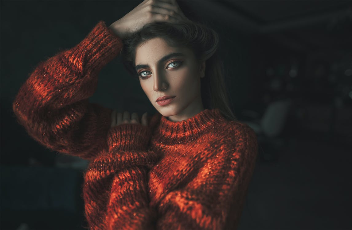 Beautiful woman in a red sweater