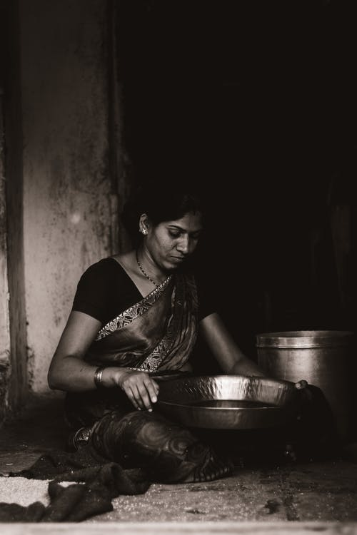 Asian Woman Working in Kitchen