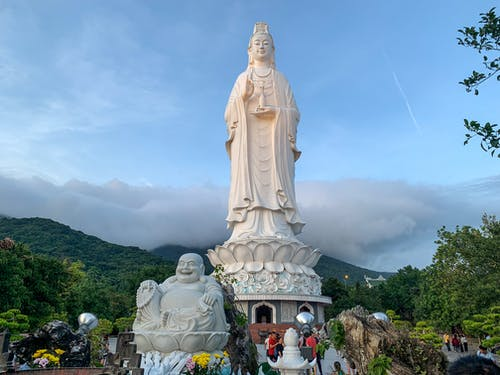 Low angle of aged Lady Buddha Da Nang statue located on territory of Linh Ung Pagoda in Vietnam