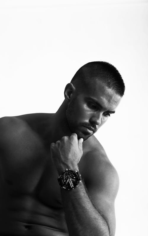 Topless Man Wearing  Wrist Watch Holding His Chin