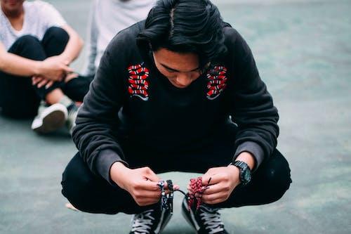 Man Holding Four Rastaclat Bracelets