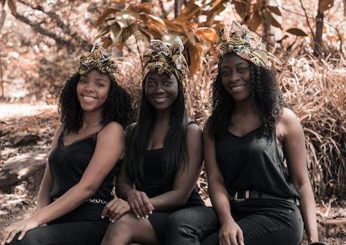 Three Women Seated Smiling