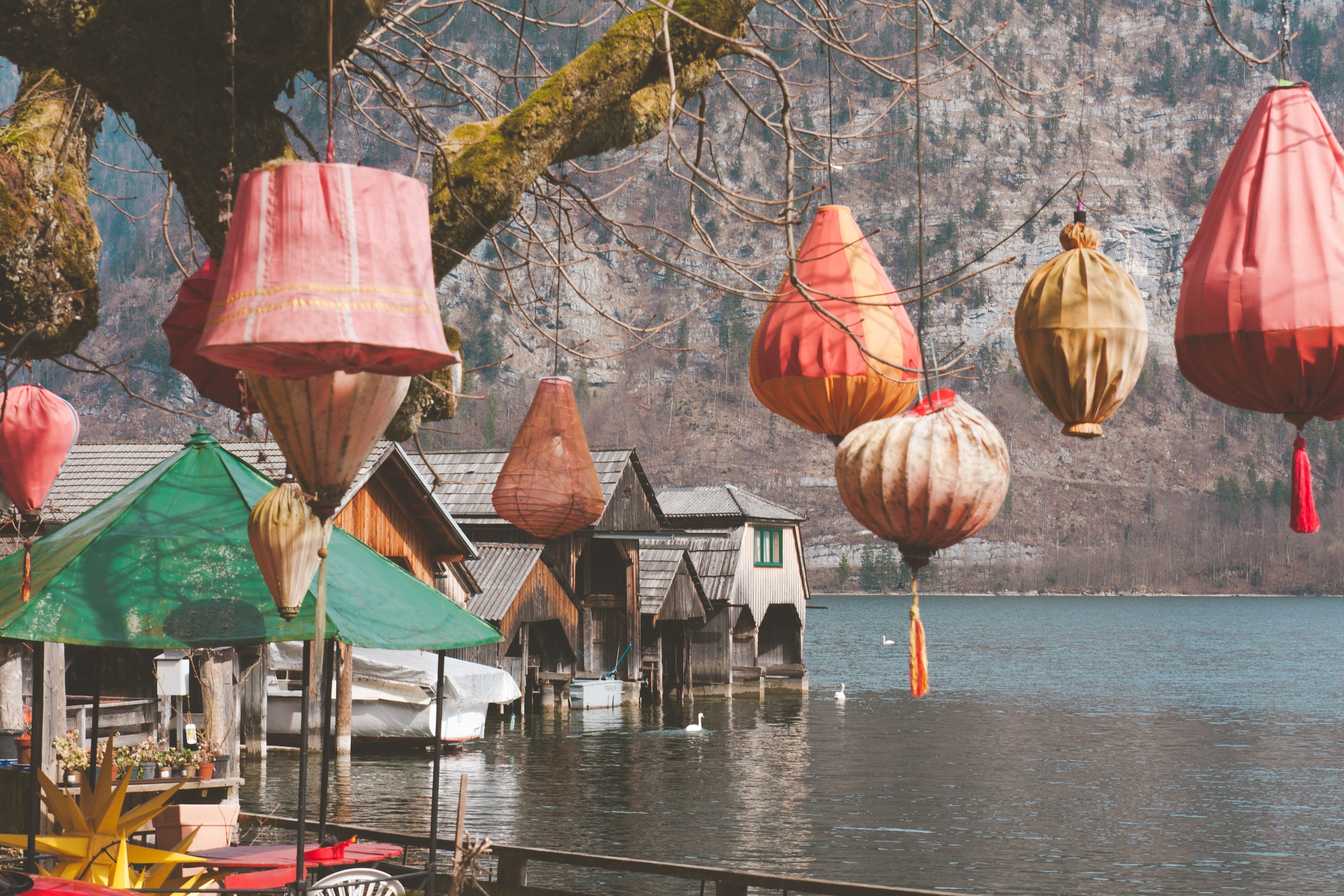Houses With Lanterns Near Body of Water