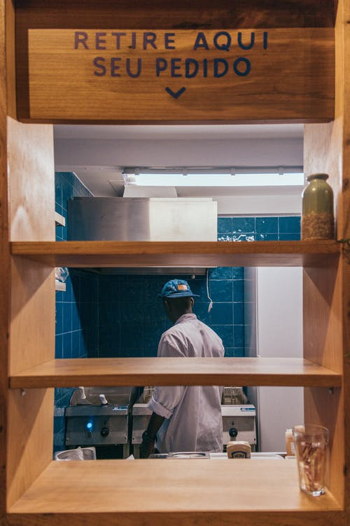 Man Standing in The Kitchen