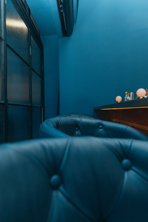 Blue Leather Sofa Beside Brown Wooden Table