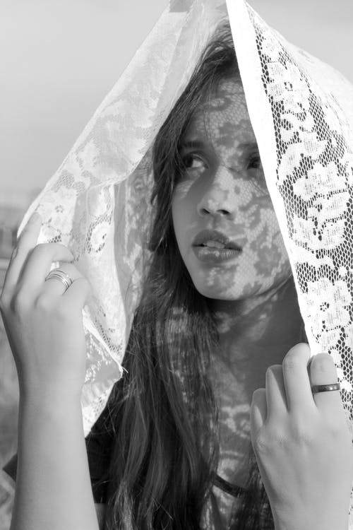 Grayscale Photo of Woman Covering Her Face With White Veil