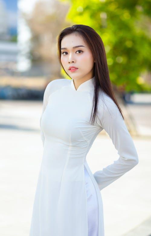 Woman Wearing White Long Sleeve Dress