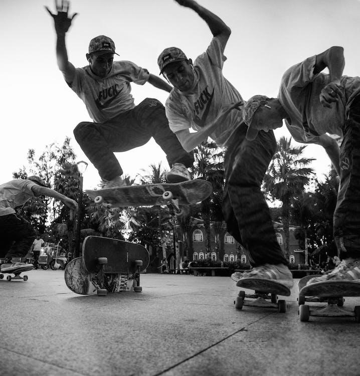 Grayscale Photo of Man on a Skateboard