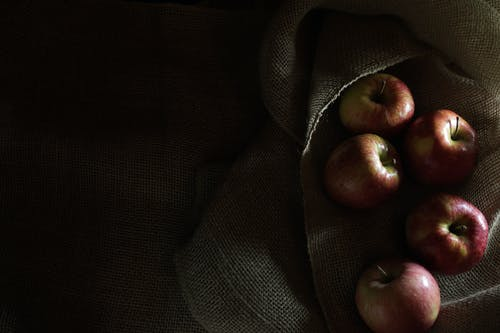 Red Apples on top of Textile