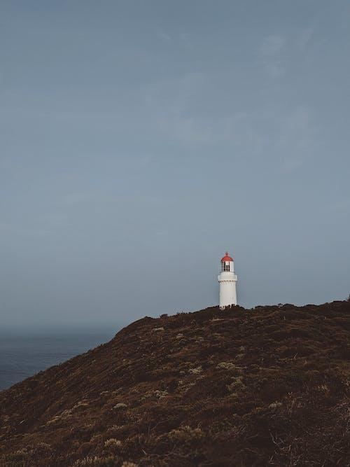 Gratis lagerfoto af bakke, fyrtårn, hav, havudsigt