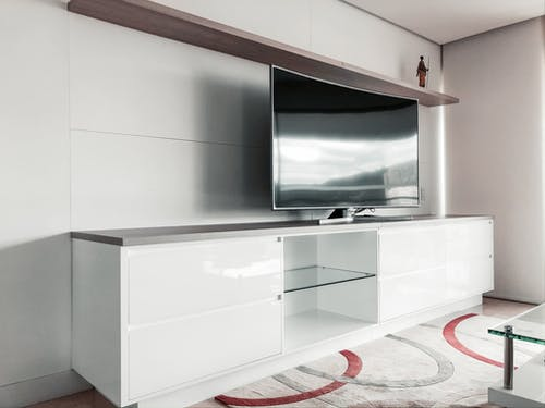 Black Flat Screen Tv on White Wooden Tv Rack