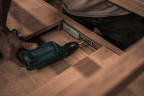 Gratis lagerfoto af bore, hånd, håndværker, håndværktøj