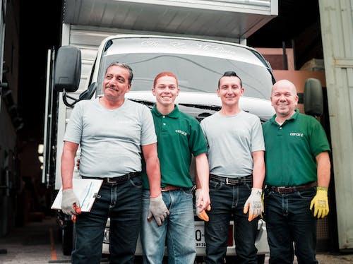 4 Men Standing Near White Van