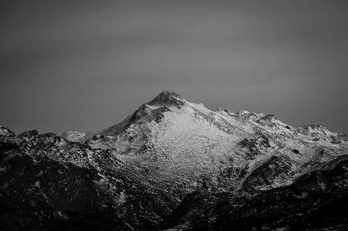 Grayscale Photo of Snow Covered Mountain