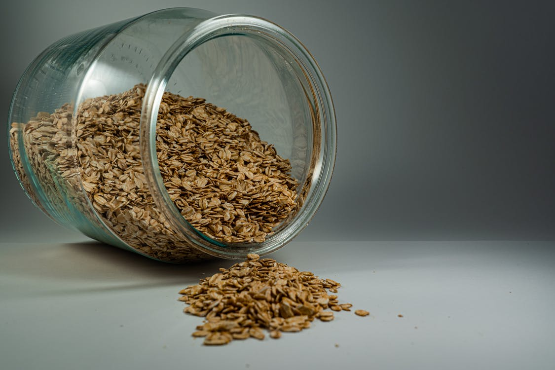 Brown Oats In Clear Glass Jar
