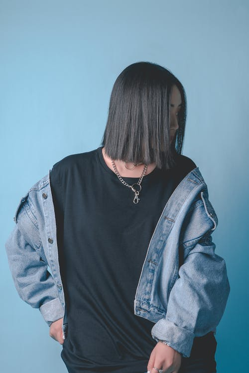 Woman In Black Crew Neck Shirt And Blue Denim Jacket