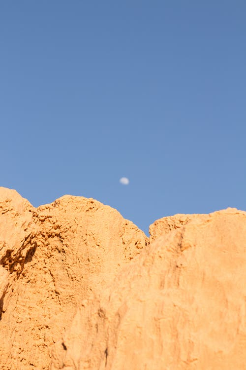 Brown Rock Formation Under Blue Sky