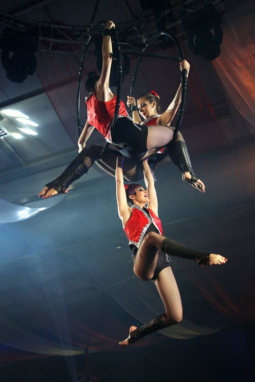 3 Women in Red and Black Circus Costume
