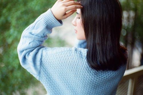 Woman In Blue Sweater