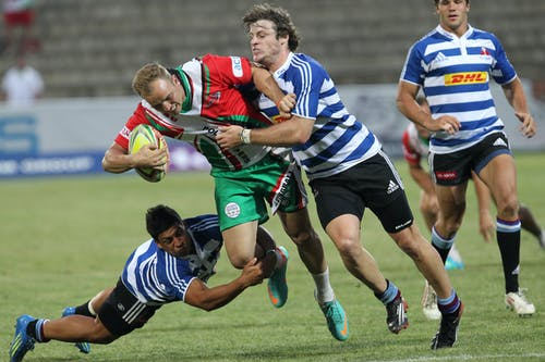 Man in Blue and White Striped Soccer Jersey Playing Rugby